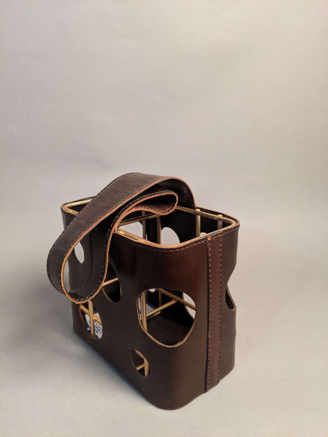 Leather bottle carrier by Jacques Adnet for JF Martell